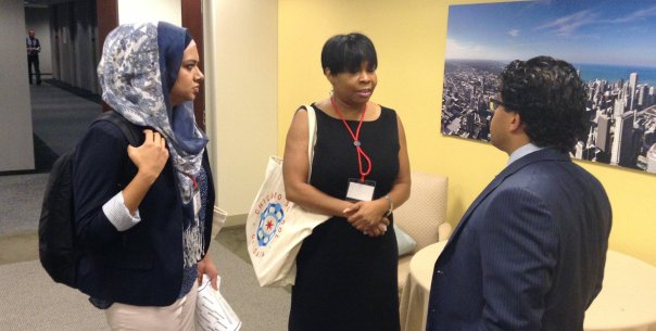 Samia Malik (left) compares notes with technologists at the Chicago School of Data conference.